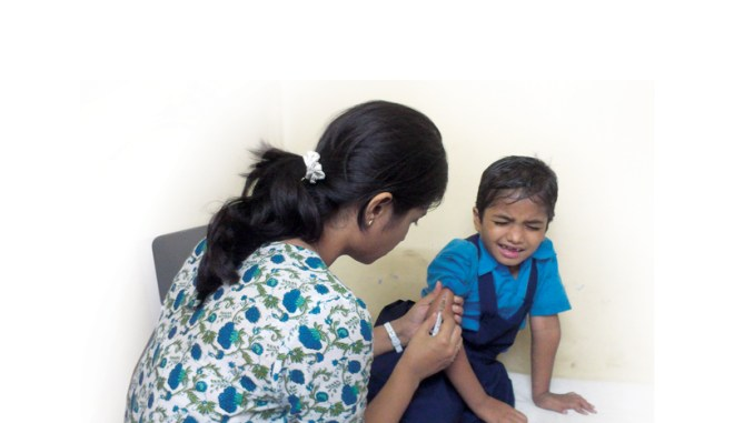 A child being vaccinated.