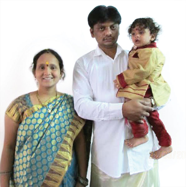 Nagadurga, a past student, with her family.