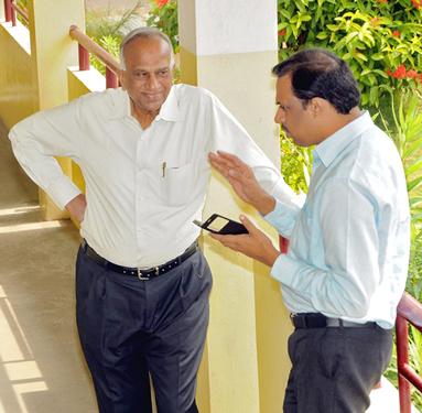 PDG S Krishnaswami with Dr K Sudhakar, a committee member.