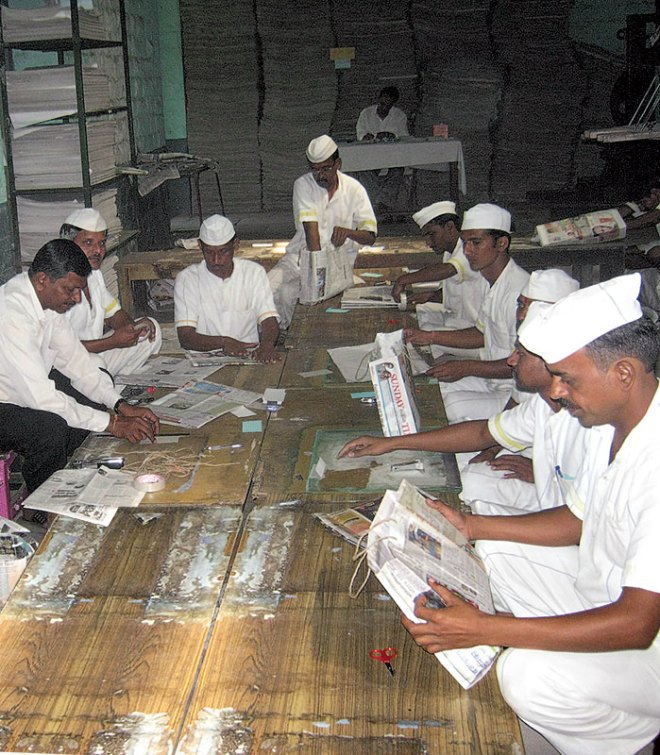 Inmates of Yerwada Prison engaged in paper bag making.