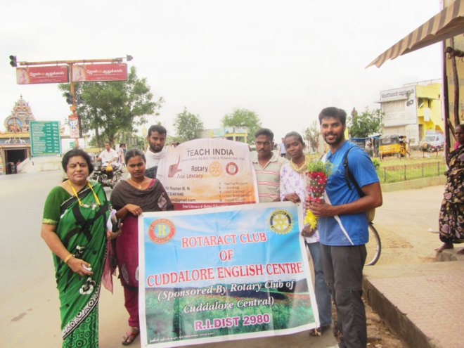 Roshan (extreme right) promoting Rotary India Literacy Mission's T-E-A-C-H programme.