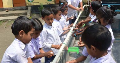 Children enjoying a handwash session in a school.