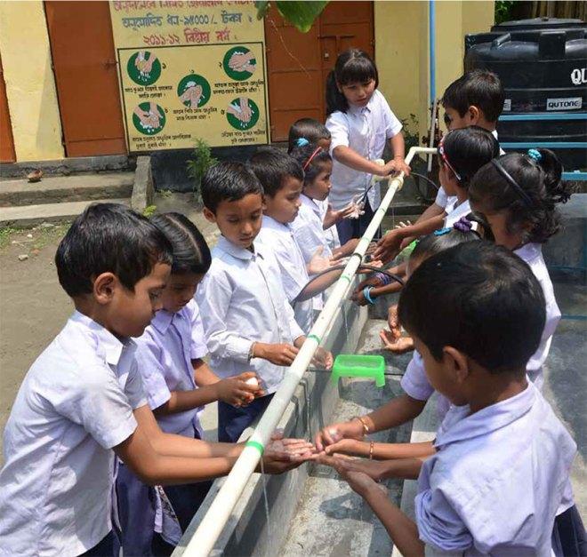 Children enjoying a handwash session in a school.