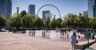 Centennial Olympic Park's Fountain of Rings splash pad is cool relief for kids and adults alike.