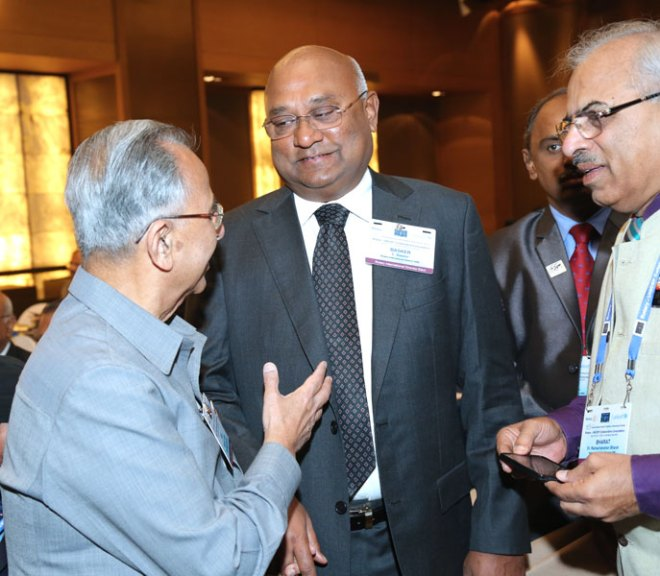 Past RI President Rajendra Saboo has a word with RIDE C Basker and DG R Bharath.