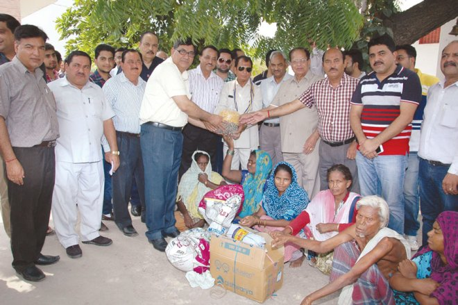 RC Rajpura RI District 3090 Grocery items and medicines distributed to residents of Lepers Colony.