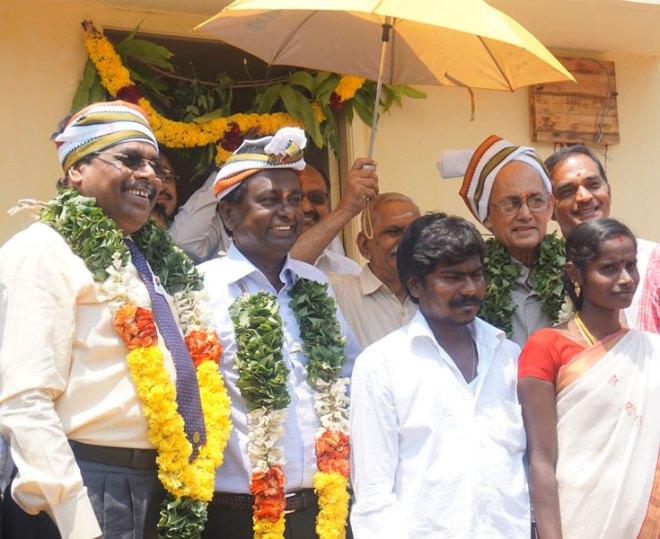 DG ISAK Nazar, RRFC Raja Seenivasan, PRIP Kalyan Banerjee, Happy Village District Chair Y Sudarsana Rao, with the new houseowners.