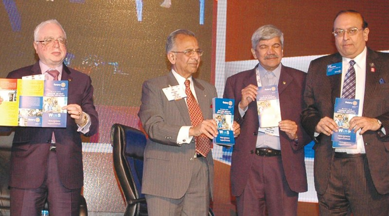 L to R: TRF Trustee Sushil Gupta, PRIP Rajendra K Saboo, PDG Vinay Kulkarni and RID P T Prabhakar releasing the WinS brochure.