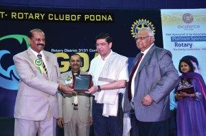 Rtn Abhay Gadgil being honoured by RIPR Rajkumar and DG Vivek Aranha.