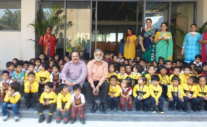 PDG Sushil Khurana and Rtn O P Pahwa along with the staff and children of the school.