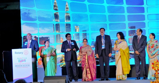 From left: RIDE C Basker and Malathi, PDG R Theenachandran and Vasanthi, PDG Deepak Shikarpur and Sonia, and PDG Sam Movva and Vijaya promoting the 2017 Zone Institute at Malaysia.