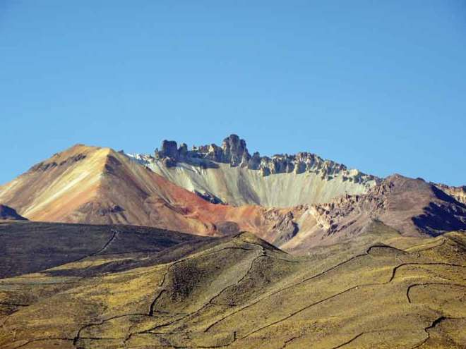 A baby volcano comes alive against a palette of mineral sub-strata.