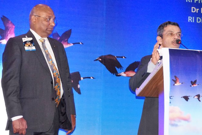RIDE C Basker looks on as Disha Chairman PDG Bharat Pandya addresses a session.