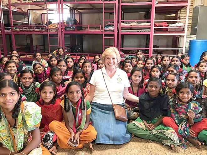 Cheryl Mader, Prairie du Chien Rotary Club exchange coordinator, enjoyed a personal Rotary Friendship Exchange to three communities in India recently. She is pictured in a girls hostel in Vapi, Maharashtra.