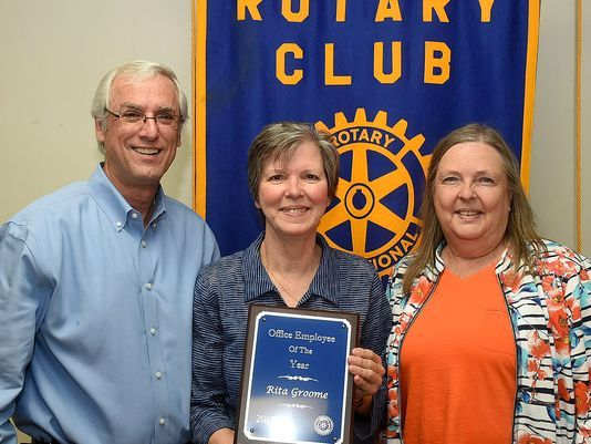 Rita Groome (centre) was chosen as the Opelousas Rotary Club's Office Employee of the Year during the club's weekly luncheon meet. At left is her employer, Craig LeBouef of Going, Sebastien, Fisher and LeBouef, LLP, and Susan Littion, a club representative. Photo: Freddie Herpin, Daily World
