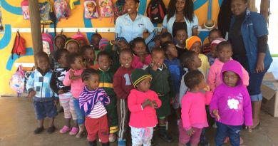 Zandile Khoza, with the headdress,  and children who can now attend a creche which provides childcare and education because of a donation from the East Cooper Rotary Club.