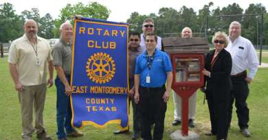 The first Rotary Club EMC Free Library was unveiled at Bull Sallas Park in New Caney, Texas. From left to right are Porter High School teacher Robert Barham, Rob Burgess, Jose Diosado, NCISD Superintendent Kenn Franklin, Rotary Club President Melecio Franco, Scott Castleberry, Barbara Knox and Montgomery County (precinct 4) Commissioner Jim Clark.