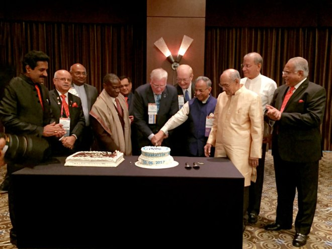PRIP Rajendra Saboo and RIPE Ian Riseley cutting the TRF Centennial cake in the presence of (from R) RID Manoj Desai, IPRIP K R Ravindran, TRF Trustee Chair Kalyan Banerjee, incoming Chair Paul Netzel, SA Reception Chair Ranjan Dhingra, RIPN Sam Owori, RIDE C Basker, Reception Co-chairs Vinaykumar Raikar and John Daniel.