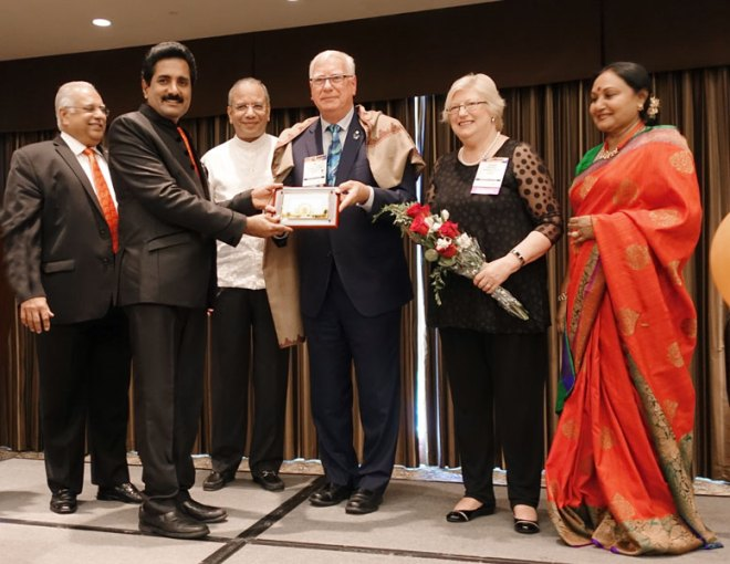 SA Reception Co-chair John Daniel presents a memento to RIPE Ian Riseley and Juliet in the presence of (from L) RID Desai, IPRIP K R Ravindran and Vanathy.