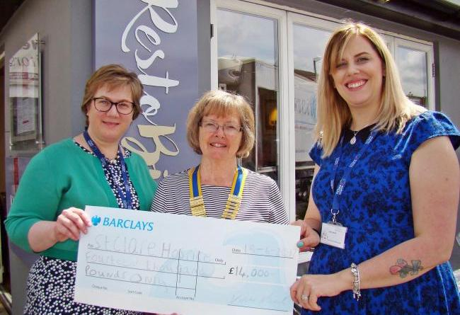 A cheque was presented to St Clare Hospice after a successful golf day.