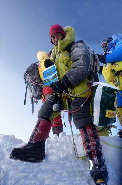 Pema Sherpa atop the Mt Everest with the banner of RC Darjeeling.