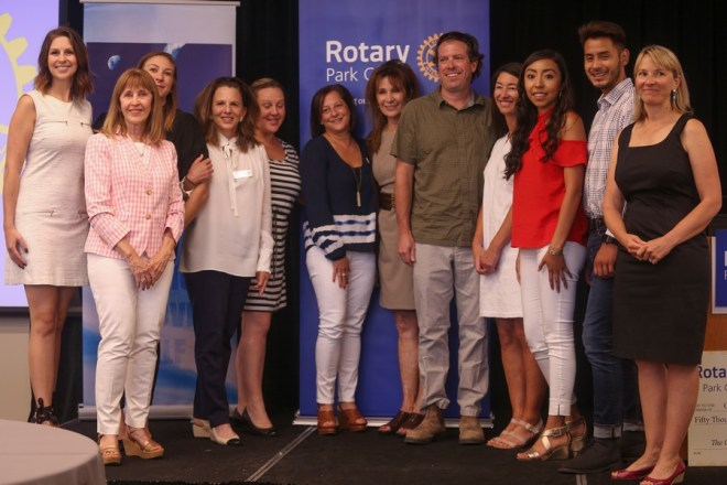 Representatives from three nonprofits and the Park City Rotary Club pose after a ceremony in which the club presented them with a combined $125,000 in grants. The organisations will use the money to help children.