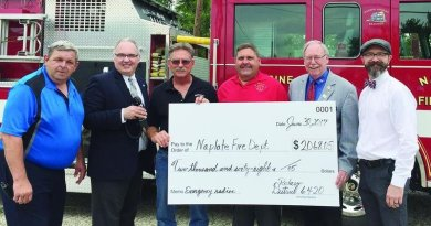 Rotary District 6420 Governor Scott Shore presented a cheque to the Naplate Fire Department for emergency radios. Also pictured are Naplate Mayor Jim Rick (from left), Ottawa Sunrise Rotary President Mike Fuller, Naplate Fire Chief John Nevins, fireman Bob Rick, Shore, and Ottawa Noon Rotary President Robb Hasty.