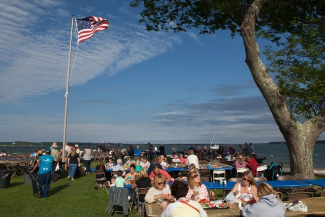 Families, friends and neighboUrs gather at the waterfront in Southold for the popular lobster festival. Photo: Katharine Schroeder