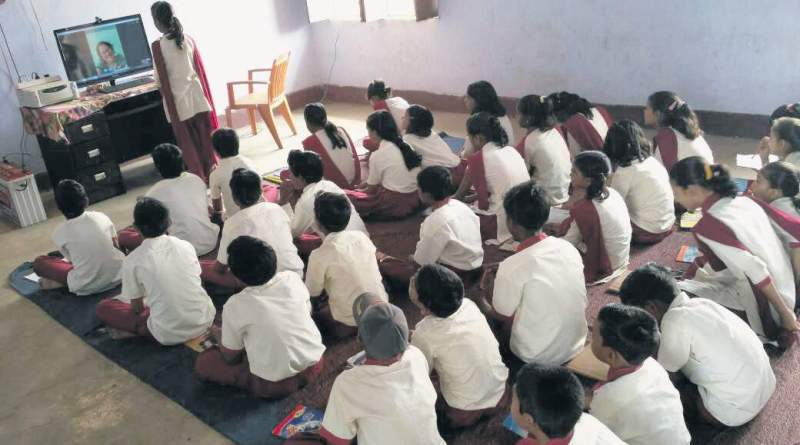 Children learn lessons in their local language digitally thanks to E-vidyaloka's volunteers.