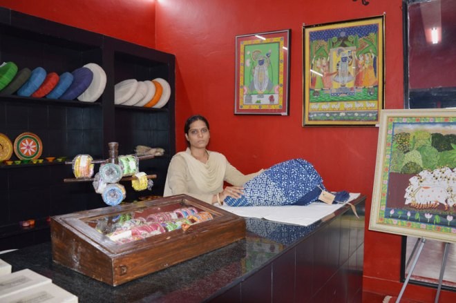 Constable Sampatti displays some of the products designed by the women detenues.