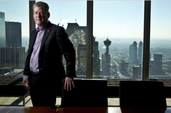 Mark Starratt, co-chair of the host organising committee for the International Rotary convention, poses for a snap at his office in Calgary. Photo: Leah Hennel / Postmedia