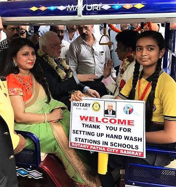 TRF Trustee Sushil Gupta, DG Vivek Kumar and spouse Varsha take a ride on an e-rickshaw along with a school student.