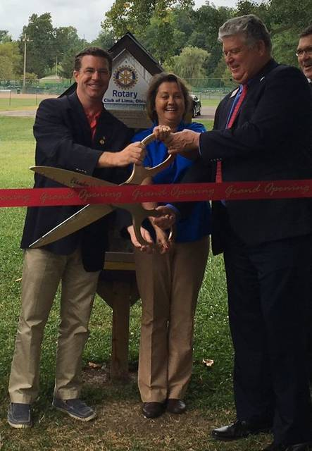 A ribbon cutting ceremony was held at Faurot Park for the Lima Rotary's Little Free Library project. From left: David Frost, past president of the Lima Rotary Club, Tracie Sanchez, president of the Lima Rotary Club and Jed Metzger, president Lima/Allen Chamber of Commerce. Photo: Merri Hanjora