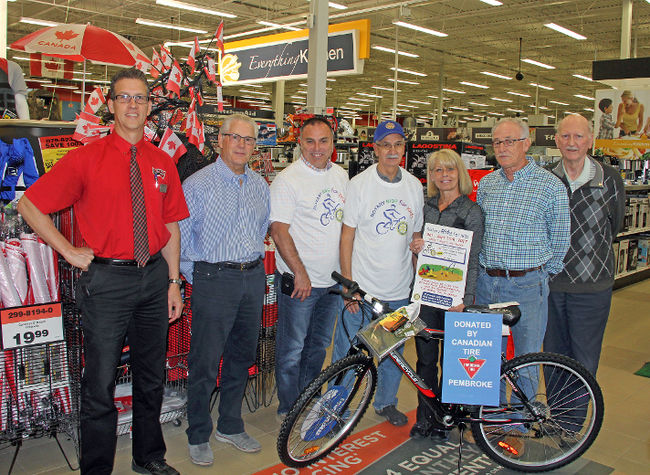 Canadian Tire Pembroke has donated this bicycle to be used as a prize for the 'Rotary Ride for Kids' fundraiser. In the photo are, from Left to Right, John Birch, Canadian Tire store manager, Rick Johnson, Canadian Tire store owner, Jerry Novack, The Grind director, and members of the Rotary Club of Pembroke, who are Andre Lafrance, Chris St Jean, Michael St Jean, and John Escott.