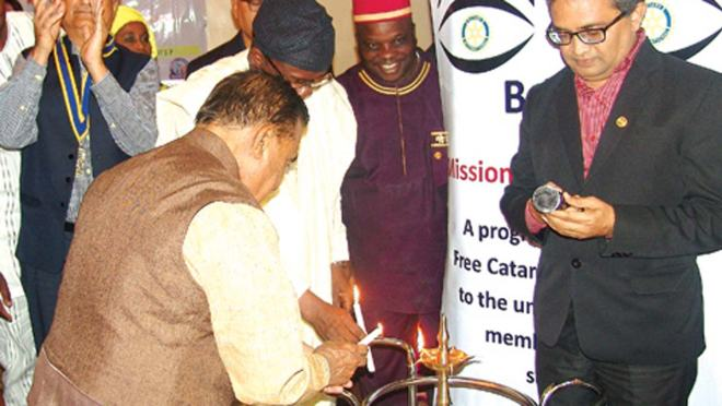 Club President Atul Ktshery (left) and DG Wale Ogunbadejo look on as Patel lights candle to launch Mission for Vision 2017 with Project Chair Tarun Sanghvi (right). Photo: Isaac Taiwo