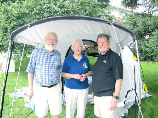 Arthur Walker chats with Ingrid and Doug Detweiler at a ShelterBox display in Concord Centre.