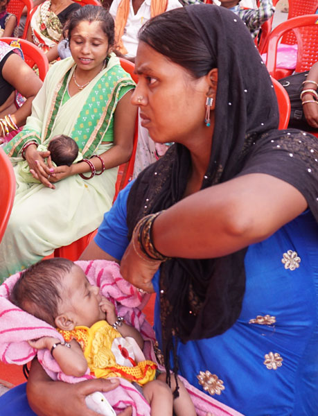 Parents waiting with their children for consultation at the CHD screening camp in Patna.