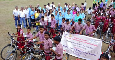 Rotarians of RC Bombay Juhu Beach with student-beneficiaries of the club's bicycle project.