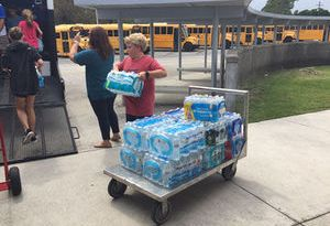 Broad Creek Middle School sixth grade student Drew Strickland helps load bottled water into a truck for Hurricane Irma victims in Florida. The Swansboro Rotary Club transported relief supplies to Marathon, Florida. Photo: Submitted
