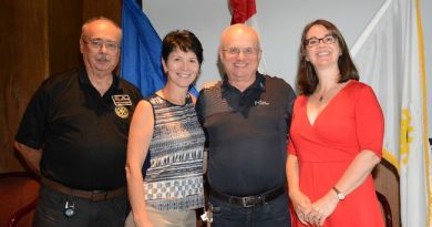 From the left, Rotary District Assistant Governor Ed Holtner, Rotary Foundation Chair Nevis Prufer, charter member Arnie Olexan and acting president Holly Astill pose together during the Whitecourt Rotary Club meeting at Ritz Cafe and Motor Inn. Photo: Peter Shokeir / Whitecourt Star