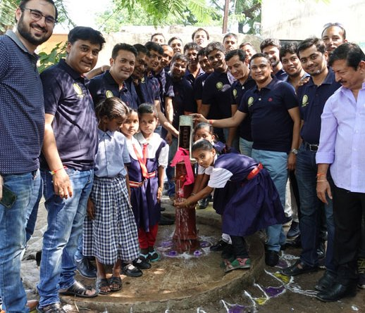 RC Jalna Midtown President Anup Karwa (with his hand on the pump), President-elect Dinesh Chhajed (to his right) and Assistant Governor Kishor Punjabi (extreme right) inaugurate Project Taral in a school.