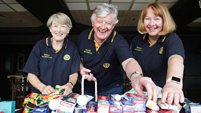 Rotarians Sue Terry, David Stewart-Hunter and Jane Reed at Balgowlah RSL Memorial Club where they filled used handbags with essentials for homeless women. Photo: Adam Yip