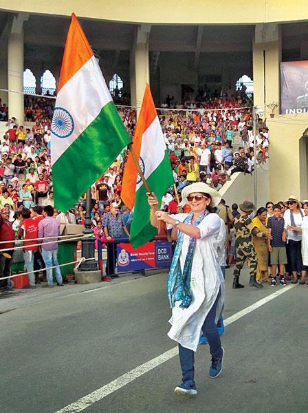Ann Nita Parikh marching with the National Flag at the Attari-Wagah Border.