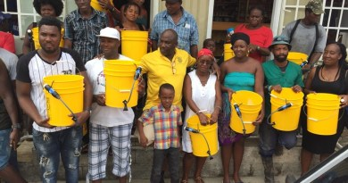Dominicans with water filters and buckets.