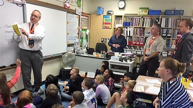 Anna Reynolds School students listen as Rotarian Robert Randich explains the various uses of a dictionary. Looking on is teacher Rebecca Voisine along with Rotarians David Johnson and Mike Turgeon. Photo: Community Contributor