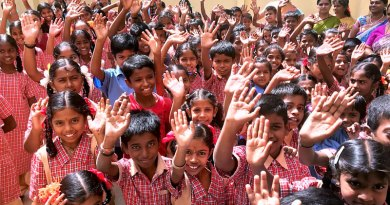 Happy children in a school made 'happy' by Rotarians of RC Bangalore.