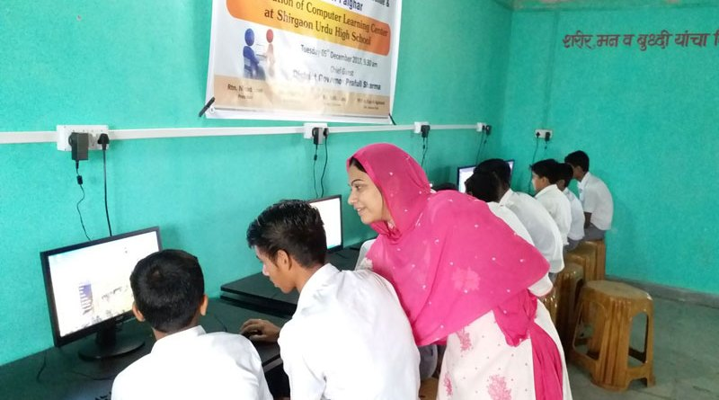 Boys learning computer at the centre set up by RC Palghar in the Urdu High School, Shirgaon.