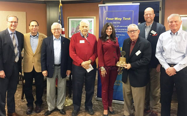 At the satellite club's first meeting were President and CEO of Epworth Villa Ron Kelley, left, Rotary District Governor Hal Stevens, Paige Dobson, Dr. Gib Gibson, Jeanean South, Stan Kelley,  Edmond Rotary Club President James Kerr, and Yukon Rotary Club President Bill Baker. Photo: Submitted