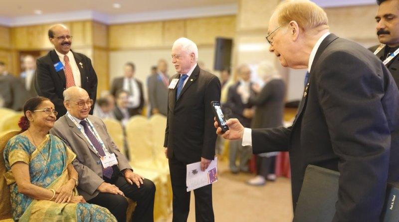TRF Trustee Chair Paul Netzel clicks a picture of PRIP Kalyan Banerjee and Binota as TRF Trustee Sushil Gupta and PDGs Rajkumar and John Daniel look on.
