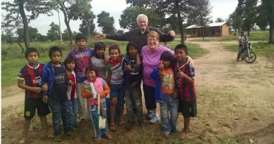 Victor-Farmington Rotarians Russ Perrin and Karen Parkhurst interact with children in El Paraiso, Paraguay. Photo: Dave Luitweiler